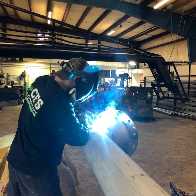 custom risers being welded